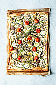 Puff pastry pizza with summer vegetables