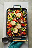 Oven vegetable salad with goat cheese