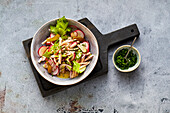 Crispy poultry salad with celery and radishes