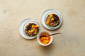 Avocado-chocolate mousse with physalis and pistachios