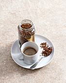Soluble coffee in cup, glass jar and spoon
