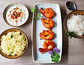 Grilled Tandoori prawns with rice