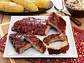 BBQ baby back pork ribs with corn on the cob and cole slaw