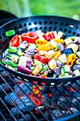 Preparing Mediterranean vegetables on the barbecue
