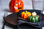 Place setting for Thanksgiving festive dinner decorated with pumpkins