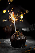 Chocolate muffin with sparkler