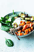 Buddha Bowl with sweet potatoes, Brussels sprouts, spinach and quinoa