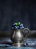 Blueberries in a vintage silver pot