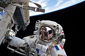 Astronaut Thomas Pesquet installing solar arrays on the ISS