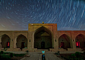Northern star trails over a caravanserai, Iran