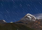 Star trails over Mount Kazbek, Georgia