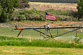 Irrigation system fitted with an American flag
