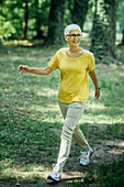 Senior woman enjoying walking in nature