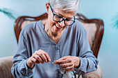 Senior woman doing crocheting