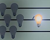 Man pushing lit light bulb, illustration