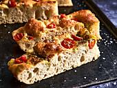 Focaccia with cherry tomatoes and pesto