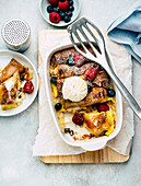 Pancake casserole with berries and ice cream