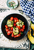 Courgette fish parcels with tomatoes