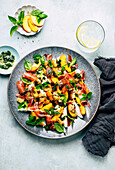 Mozzarella salad with nectarines, prosciutto and herb dressing