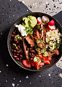 Steak bowl with chimichurri and black beans