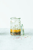 Homemade Italian Vinaigrette Salad Dressing in a Small Glass Pitcher with a Whisk