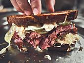 Reuben sandwich with cured beef brisket, cheese and sauerkraut