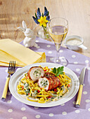 Chicken roulade with a wild garlic and cream cheese filling on tagliatelle