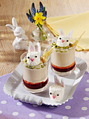 Sour cream pudding with redcurrant jelly and marshmallow bunnies