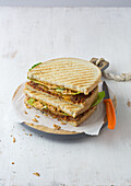 A bolognese sandwich with cheddar cheese