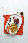 Matjes tartar with fried potatoes