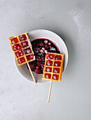 Currant waffles on a stick