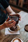 Hands holding cup with tea