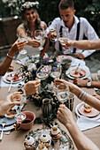 Friends having toast at wedding reception