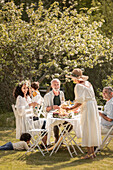 Family celebrating midsummer with a garden party (Sweden)