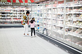 Mother with daughter in supermarket