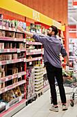 Man doing shopping in supermarket