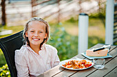 Smiling girl at table