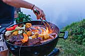 Man preparing food on grill