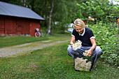 Mature woman with elderflowers in basket