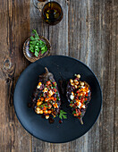 Aubergine kumpir with chickpeas and spiced butter