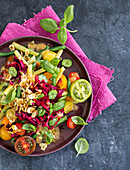Colourful bean and tomato salad with red cabbage and roasted hazelnuts