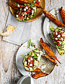 Avocados with spicy sweet potato wedges and feta