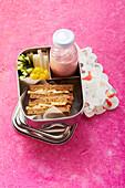 Banana and peanut sandwich with raspberry shake 'To Go