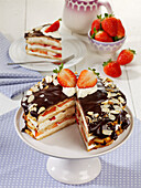 Waffle and strawberry tart with cream cheese and a dark chocolate topping