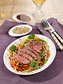 Asian beef salad with sesame seeds