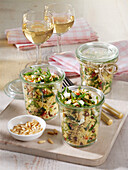 Couscous salad with vegetables, raisins and mozzarella cheese