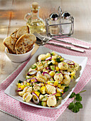 Gnocchi salad with courgettes and red onions