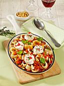 Calamarata pasta with vegetable sugo and goat's cheese