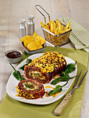 Hearty meatloaf with bacon, nachos and wasabi peanuts