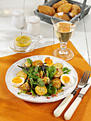 Summer greens salad with bacon, mustard potatoes and boiled eggs